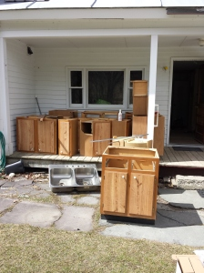 Cabinets piled up on porch - finally out of the house!