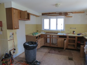 Partial demo of kitchen cabinets - uppers are down