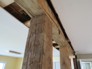 Hand-hewn beams salvaged from our shed.