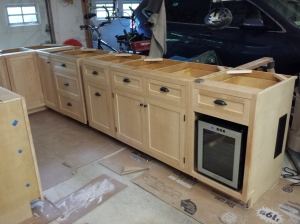 Custom made Maple cabinets...hand made by my father. (yes we have a spot for the wine cooler fridge)