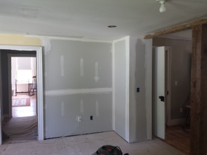 New sheetrock on back wall in Kitchen