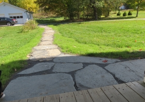 Newly installed stone walkway leading to porch off of Kitchen.